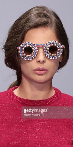 Stone Hearts Club Mexican designer Pink Magnolia during the Mercedes-Benz Fashion Week in Mexico City on April 16, 2015. - See more at: photos.thenews.co... Pink Magnolia Fetures 8 pairs Original Mercura NYC Glamorous Crystal and Art Sunglasses here round red white & blue crystal sunglasses