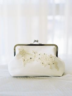 Pearl embellished wedding clutch: http://www.stylemepretty.com/2017/03/10/blending-organic-and-elegant-in-the-most-beautiful-of-ways/ Photography: Krista A. Jones - http://kristaajones.com/