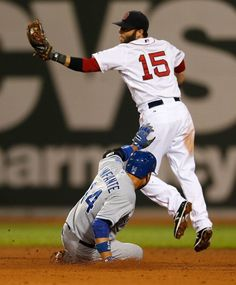 BOSTON, MA - JULY 19: Dustin Pedroia #15 of the Boston Red Sox takes a late throw as Omar Infante #14 of the Kansas City Royals slides into second base in the fifth inning during at Fenway Park on July 19, 2014 in Boston, Massachusetts. (Photo by Jim Rogash/Getty Images)