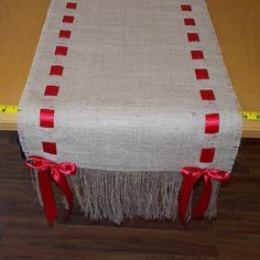 Beautiful natural burlap runner made with your choice of satin ribbon color. Select your size during checkout. Measurement INCLUDES: half inch side