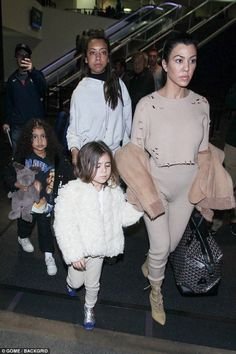 Friendship never ends: Kourtney had a pal in tow as the group made their way through the t...