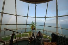 Stay a weekend at the old stone Llandudno Lighthouse, Great Ormes Head, Wales, in its most famous suite, The Lamp Room.