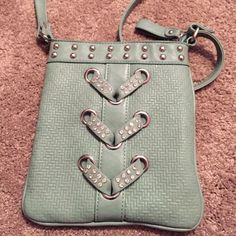 Green crossbody purse Green crossbody purse.  In great condition! Hardly used. As you can tell in the 4th picture, I cut the strap because the excess material got to be annoying at times. Super cute and fits a lot of stuff :) Bags Crossbody Bags