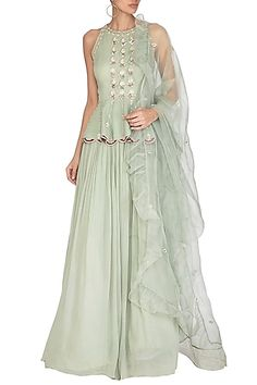 Featuring a sage green halter neck peplum top with hand embroidery. It is paired with matching lehenga skirt and ruffled dupatta in organza base. FIT: Fitted at bust and waist. CARE: Dry clean only. Peplum Top Outfits, Peplum Blouse, Long Blouse, Lehenga Skirt, Lehenga Blouse, Pernia Pop Up Shop, Indian Ethnic Wear, Designer Dresses, Designer Clothing