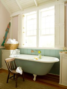 Colors for Cottage Style  While white evokes the bright, cheerful feel that cottage style embraces, soothing, muted colors are a perfect complement, too. Faint aqua-green on the plank wainscoting and claw-foot tub adds energetic character to this bathroom. Another trademark cottage-style feature: window shutters.