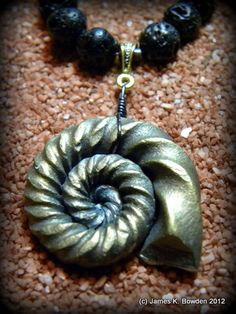 "Steel (fossil) Ammonite Pendant (with iron pyrite ""look"") on necklace, forged by James K. Bowden."