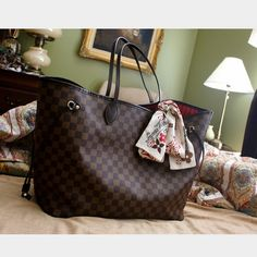 Neverfull Selling my Louis Vuitton Damier neverfull. Great condition. Just not my type of bag. Comes with dust bag and receipt. Please do not harass me if you feel price is too high. If you do not want to buy simply move on. Happy poshing!! Louis Vuitton Bags Totes