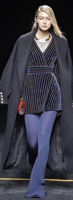 Gigi Hadid walked the runway at Balmain in a jacket and sheer pants during Paris Fashion Week