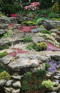 Chelsea FS 1994. Design: Peter Tinsley. Alpine rock garden, Spring flowering alpine perennials May, by John Glover.