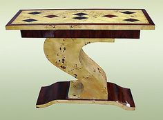 #ART_DECO  This superb console table in Art Deco style is made with geometric marquetry . It is made with Elmwood and rosewood. It is the symbol of the Art Deco wonderful style.