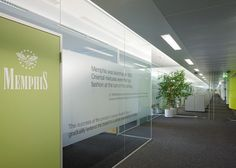 glass wall overlay with type on it, graphics beneath it