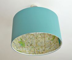 Turn a plain Ikea lampshade into something more stylish with this Ikea lamp hack using maps. Use your favourite maps and have a different one for each room.