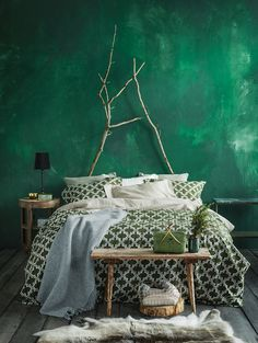"Love the wall color and the bedding. I would lose the Blair Witch Project ""headboard"" though..."