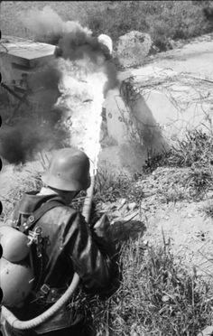 A German soldier with a Flammenwerfer 35 in Northern France, 1944.