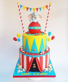 Top tier is chocolate cake and bottom tier is vanilla cake. The ball on top is made from Rice krispie treats. Carnival Birthday Cakes, Circus Theme Cakes, Dumbo Birthday Party, Circus First Birthday, Circus 1st Birthdays, Carnival Cakes, Circus Theme Party, First Birthday Parties, First Birthdays