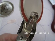 Use a hole punch to make a straw hole in mason jar lid and cover with paper or adhesive backed drawer liners.