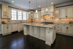 Need to spruce up your kitchen? Consider adding under the counter lighting like the homeowner's of this gourmet kitchen did.