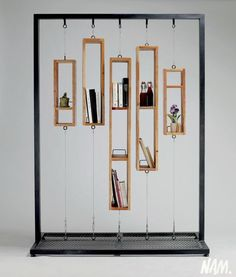 "A remanier pour faire une ""partition"" sur roulettes The lack of space for books is so astonishing that I cannot in good conscience call it a bookshelf, but it is an innovative and attractive decoration. Perhaps a room divider or window screen of sorts. Home Design, Diy Furniture, Furniture Design, Mirrored Furniture, Furniture Online, Decoration Evenementielle, Book Storage, Art Storage, Storage Shelves"