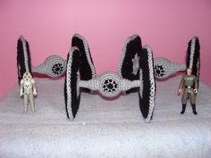 Ahahaha! Crocheted Granny square TIE fighters...