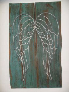 This is a beautiful piece of wall decoration. It is made of beautiful metal angel wings attached to pieces of barn wood painted an amazing turquoise then distressed and antiqued. This is a beautiful display piece for any wall in your home!!    Dimensions: 32 tall x 19wide x 1thick * Contact us for shipping quote    **PLEASE DO NOT PURCHASE WITHOUT CONTACTING US FOR A SHIPPING QUOTE