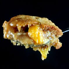 Caramel Peach Cobbler. The batter rises from the bottom to form a crispy, cakey, cobbler crust. Great with apples or pears too! #cobbler