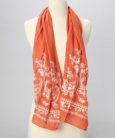 Wrap up in lush luxury with this chic scarf. A juicy hue and classic, charming embroidery are sure to complete a stylish ensemble.