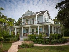 DIY Network's Blog Cabin 2013 is a circa-1892 coastal cottage located along the Crystal Coast in North Carolina. The home has been remodeled, based on online voters' selections, and will be given away to one lucky winner in a home sweepstakes in Fall 2013. Pictured is the front yard.