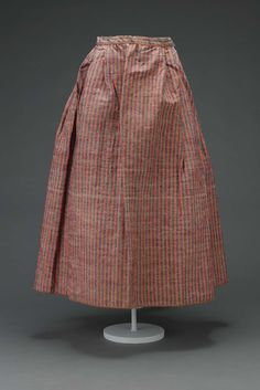 Petticoat; English or French; late 18th century. Striped red and blue heavy wool and linen with wool binding tape and ties. Museum of Fine Arts, Boston.
