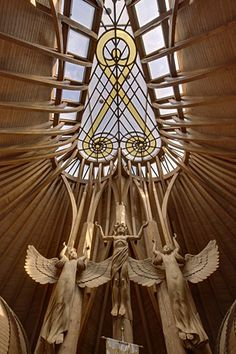 Holy Spirit Church in Paks, Hungary. Designed by Imre Makovecz.oh Holy Spirit come in Your fullness to my beloved Hungary. Organic Architecture, Architecture Details, Gaudi, Architecture Organique, Angel Sculpture, Glass Photography, Church Interior, Angel Statues, Angels Among Us