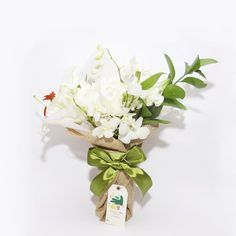 Poised White Bouquet-The epitome of an elegant bouquet with pure white florets and a touch of green ruskus.