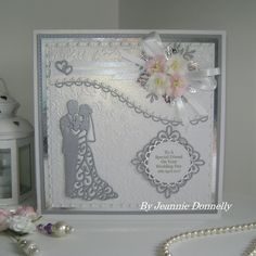 I have a Wedding Day card today using dies from #CreativeExpressions / Sue Wilson - Nobel Double Pierced Squares and Circles Special Occasion, Happy Couple Canadian Collection, Tag Finishing Touches, Camellia Open Petals (leaves) Delicate Fronds also using two Spellbinders dies - A2 Curved Borders One Lacey Circle.