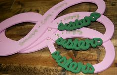 Pink and green 'Infinitely Sisters' wood signs
