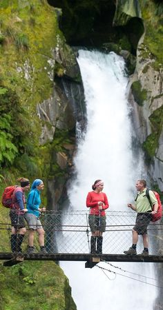 Walkers at Giants Gate Falls - Milford Track,South Island, New Zealand