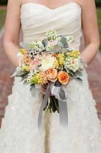 This subtle wedding bouquet is so fabulous for a spring celebration. Incorporate oranges, yellows and greens for a fresh look!