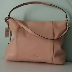 Coach Isabelle crossbody bag   NWT *east / west pebbled leather crossbody  *one hidden outside zip pocket  * goldtone hardware  * one inside zip pocket and two multifunction pockets  *adjustable and removable shoulder strap  *ask for additional photos if needed  *style f35809 peach rose * $ 350 manufacturer list *comes with a Coach gift receipt  *no trades Coach Bags Crossbody Bags