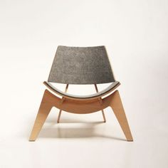 Modern chair with felt and plywood. Love the lounge style.