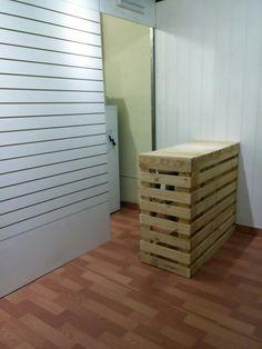 Mostrador para tienda hecho con palets reciclados.