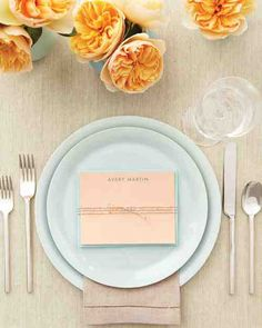 PLACE CARD STATIONERY  Let guests know exactly where they're sitting by putting personalized correspondence cards, which pull double duty as favors, at each setting.