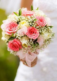 Traditional roses  baby's breath, this would definitely work also a DZ brides bouquet