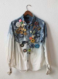 Brooches pinned to denim shirt.
