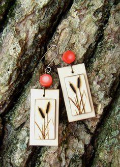 Wood Burned Cattail Earrings with a Coral Bead (would make pretty necklace pendants) Wood Log Crafts, Old Book Crafts, Wood Burning Crafts, Wood Burning Patterns, Wood Burning Art, Homemade Crafts, Diy And Crafts, Chalk Crafts, Dremel