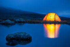 The comforting glow of the tent is doubled as it reflects of the still water of a pond Beach Camping, Tent Camping, Camping Ideas, Photo Tent, Festival Camping, Camping Photography, Blue Hour, Night Photos, Under The Stars