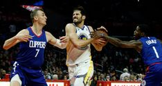 Golden State Warriors forward Omri Casspi, center, drives between Los Angeles Clippers forward Sam Dekker, left, and guard Jawun Evans during the second half of an NBA basketball game in Los Angeles, Saturday, Jan. 6, 2018. The Warriors won 121-105. (AP Photo/Alex Gallardo)