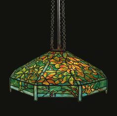 "TIFFANY STUDIOS ""WOODBINE"" CHANDELIER shade impressed TIFFANY STUDIOS/NEW YORK/609-17 leaded glass and patinated bronze 44 1/2  in. (113.1 cm) drop 26 5/8  in. (67.6 cm) diameter of shade circa 1910"