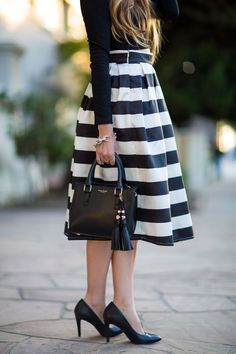 Black open back crop top paired with a striped skirt. Chic and timeless look perfect for summertime. #HelloGorgeous