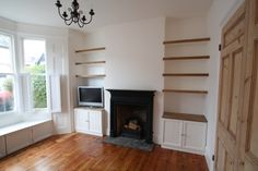 Alcove shelving and units were built for the client. These sit perfectly either side of the fireplace we installed. The restored original floorboards look great alongside the freshly decorated room. Alcove Storage, Alcove Shelving, Alcove Cupboards, Built In Shelves, Built Ins, Floating Shelves, Narrow Living Room, Living Room Shelves, Living Room Decor