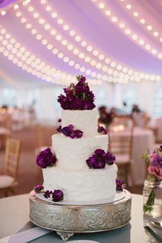 White cake with purple flowers.
