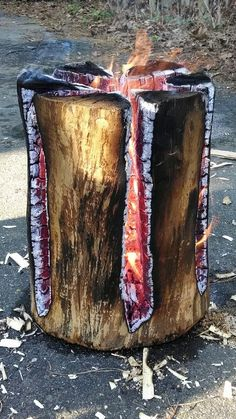 Swedish fire log - cut through a large, dry log 3/4 down with a chain saw, then light the log on top with a pile of twigs, etc. Long lasting fire!