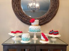 A family of desserts! Ombré petals from aqua to cornflower blue and bursts of red ruffles on a two tiered cake, two mini cakes, cupcakes and cookies! Photo on Cakes by Jess: Family Portrait: FontaineBLEU - Blue, Red, Ombré, Petals & Ruffles Galore!