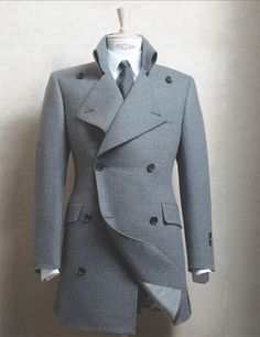 I would buy this and it would look awesome in my closet haha.  I don't wear coats but if ever I were to start, this baby would be it.  Although I think the get up under this would have to be blazer/jacket-less. This sucker looks skin tight. Still awes though.